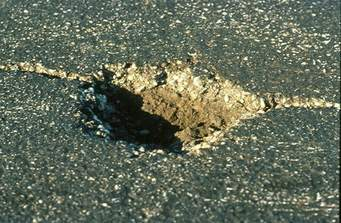 Pay A Fee To Report A Pothole...